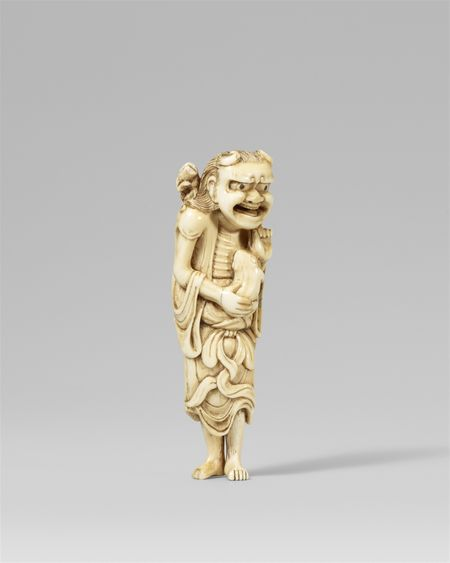 A very fine and lively early ivory netsuke of a laughing Gama Sennin, 18th century