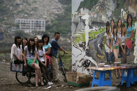 "Liu Xiaodong together with the girls in the painting ""Out of Beichuan"", Beichuan, Sichuan Province, 2010"